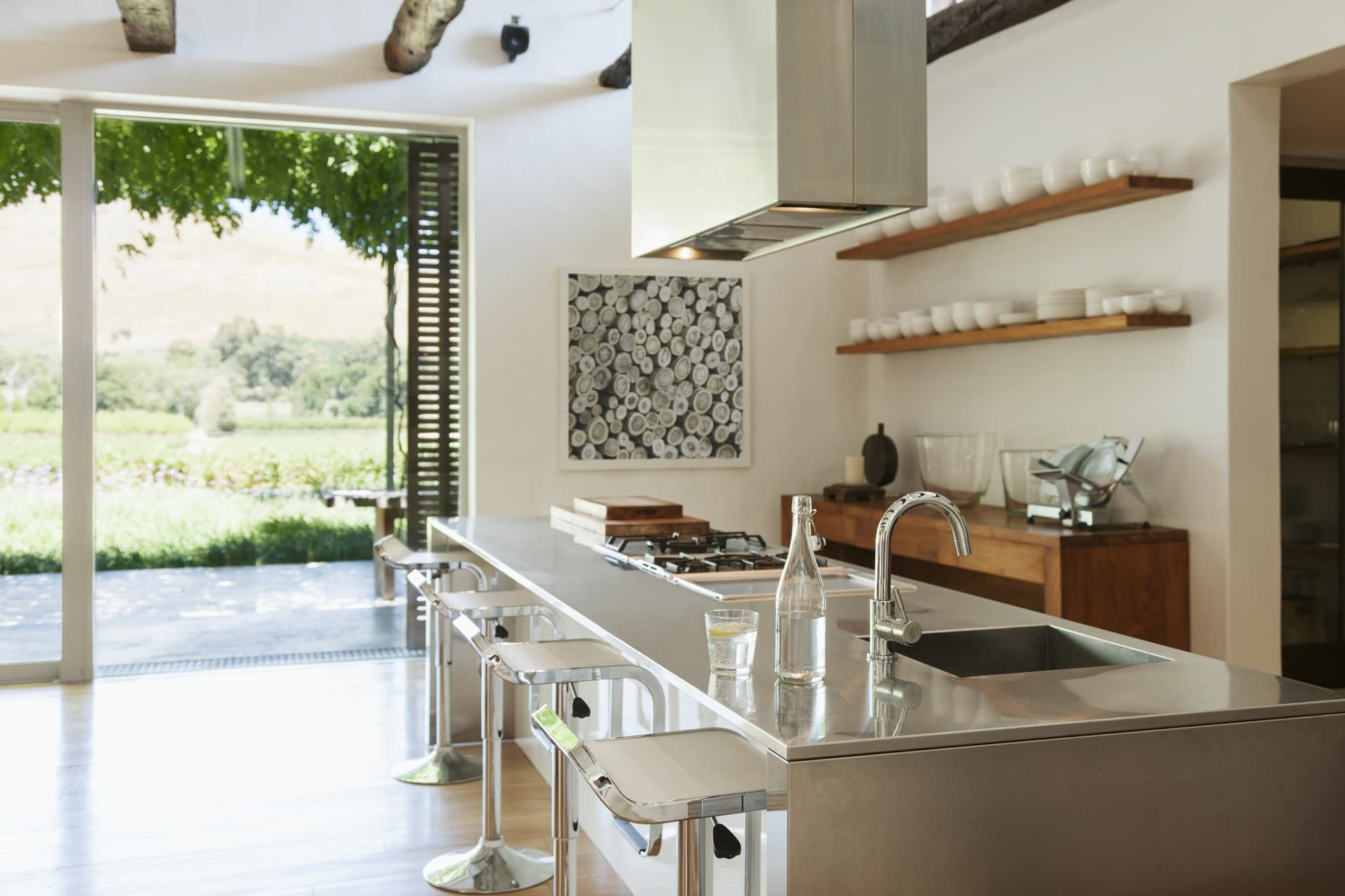 Modern kitchen overlooking patio and vineyard